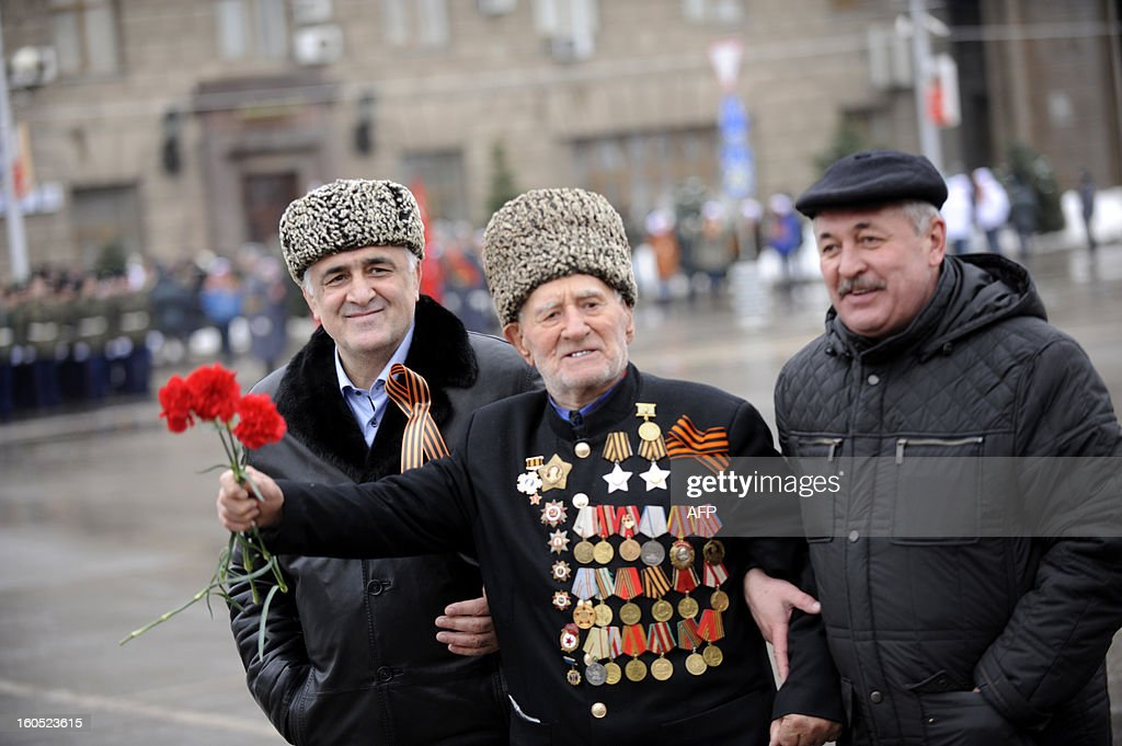 World War II veteran (C) crosses a square before a military parade marking the 70th anniversary of the Stalingrad Battle, in the Russian city of Volgograd, formerly Stalingrad, on February 2, 2013. Russia marked today the 70th anniversary of a brutal battle in which the Red Army defeated Nazi forces and changed the course of World War II.