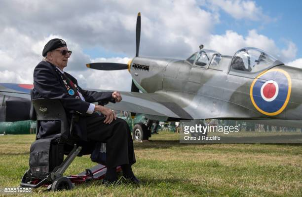 World War II veteran sits in a mobility scooter next to a Spitfire on display at the Biggin Hill Festival of Flight on August 19 2017 in Biggin Hill...