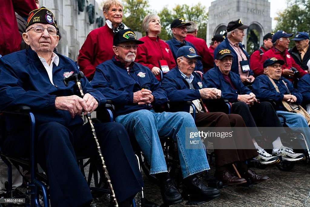 World War II veterans and their supporters from the Central Valley Honor Flight organization in California line up for a group photograph Wednesday morning at the World War II Memorial in Washington, DC., Oct. 30, 2013.