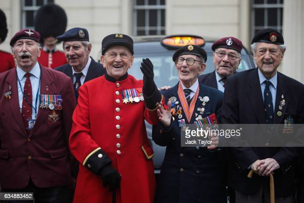 World War II veterans are pictured cheering in front of a black cab during a photo call for the launch of the Veterans Black Cab ride at Wellington...