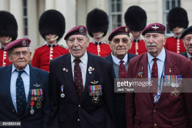 World War II veterans are pictured in front of guardsmen during a photo call for the launch of the Veterans Black Cab ride at Wellington Barracks on...