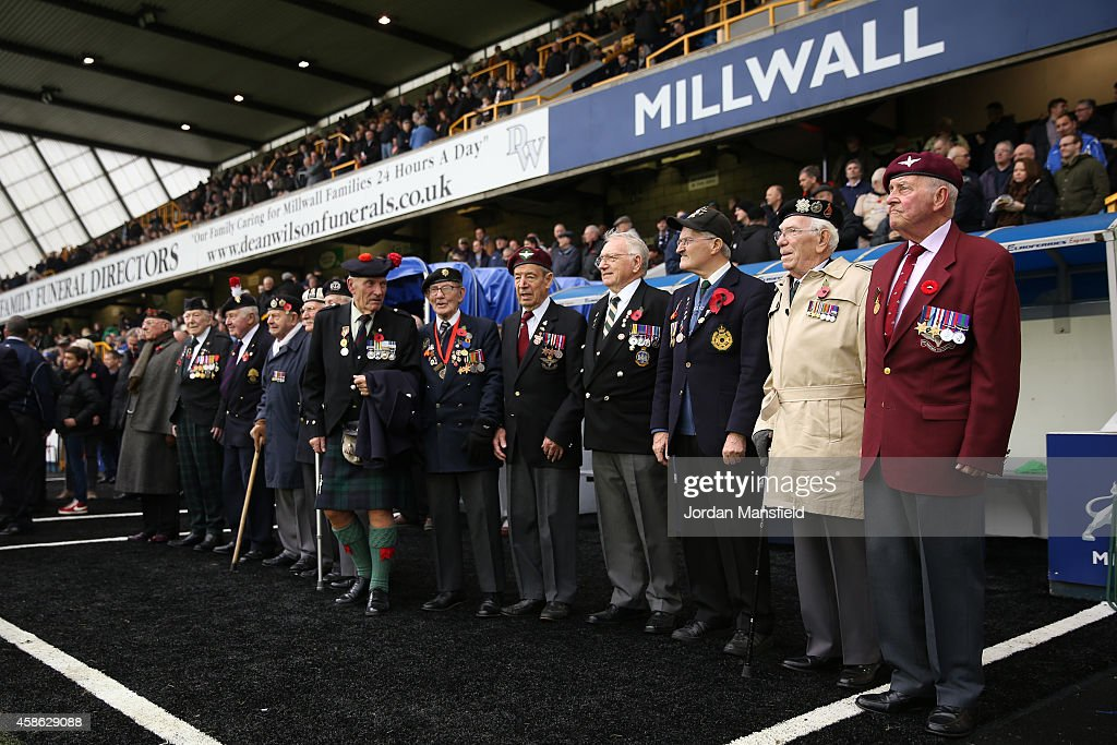 World War II veterans are welcomed pitchside ahead of the Sky Bet Championship match between Millwall and Brentford at The Den on November 8, 2014 in London, England.