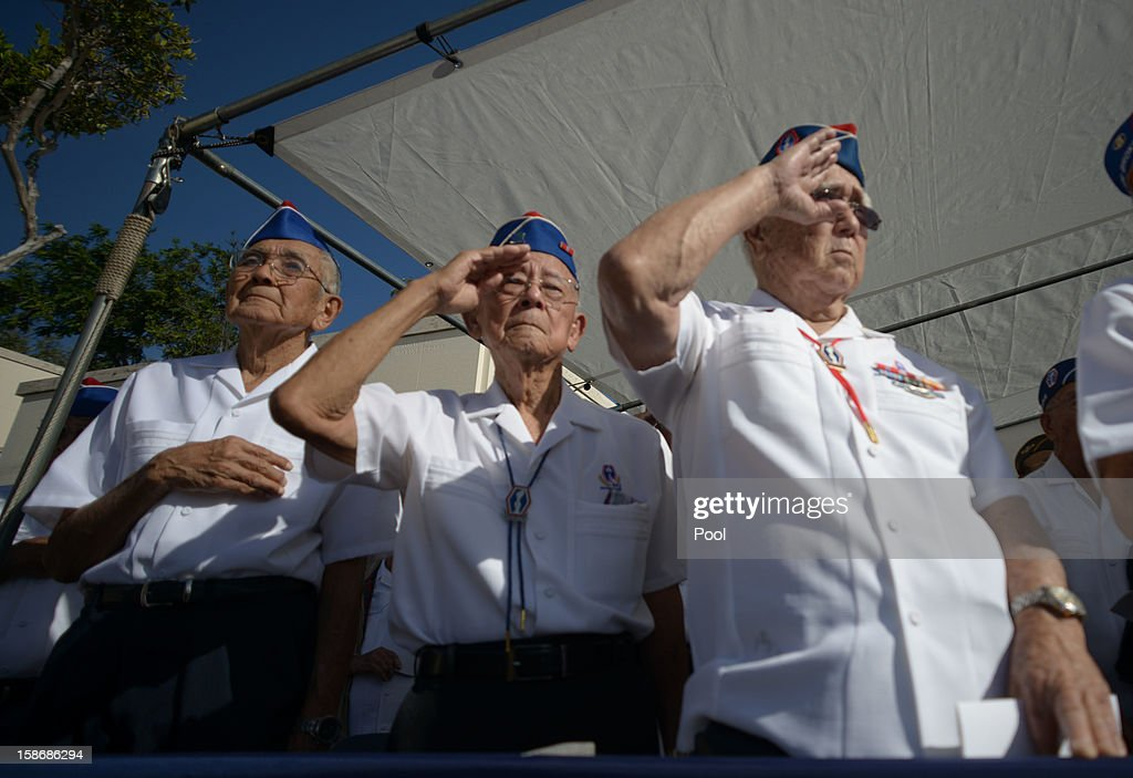 World War II veterans from the 442nd Combat Regimental Team salute during the funeral services for the late Senator Daniel Inouye at the National Memorial Cemetery of the Pacific December 23, 2012 in Honolulu, Hawaii. Senator Inouye was a Medal of Honor recipient and a United States Senator since 1963.