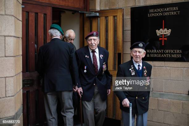 World War II veterans leave the Officer's Mess ahead of a photo call for the launch of the Veterans Black Cab ride at Wellington Barracks on February...