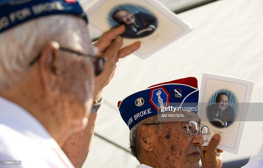 World War II veterans of the US Army 442nd Regimentsal Combat Team honor their fellow soldier as they attend the memorial service for the late Senator Daniel Inouye at the National Memorial Cremetary of the Pacific in Honolulu, Hawaii, December 23, 2012. AFP Photo/Jim WATSON