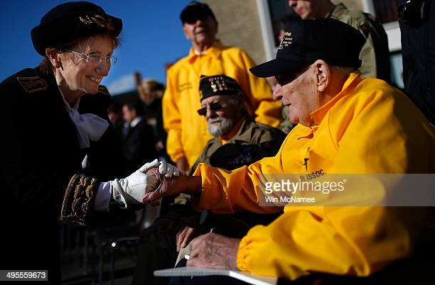 World War II veterans who took part in the invasion of Normandy William Spriggs and Francis Markuins both from the 83rd Infantry Division are greeted...