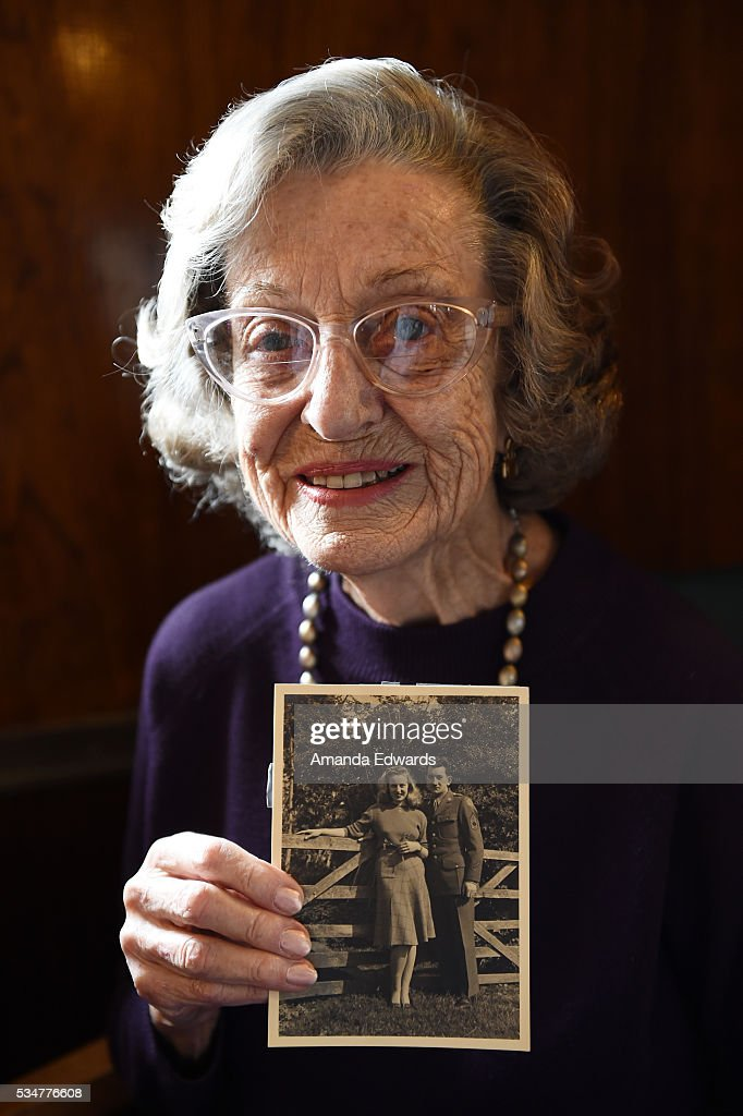 World War II 'War Bride' Jean Dahler holds a photo of herself and her first husband while attending the 80th anniversary celebration of the Queen Mary's maiden voyage at The Queen Mary on May 27, 2016 in Long Beach, California. Dahler, now 91, departed Southampton, England aboard the Queen Mary on February 3, 1946 for her new life in the United States after marrying a G.I. soldier.