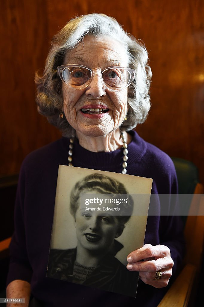 World War II 'War Bride' Jean Dahler holds a photo of herself as a young woman while attending the 80th anniversary celebration of the Queen Mary's maiden voyage at The Queen Mary on May 27, 2016 in Long Beach, California. Dahler, now 91, departed Southampton, England aboard the Queen Mary on February 3, 1946 for her new life in the United States after marrying a G.I. soldier.