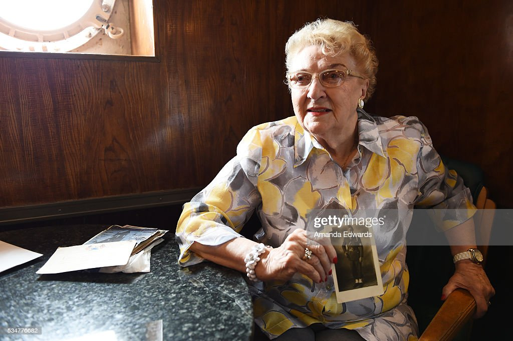 World War II 'War Bride' June Boots Allen holds a photo of her first husband while attending the 80th anniversary celebration of the Queen Mary's maiden voyage at The Queen Mary on May 27, 2016 in Long Beach, California. Boots Allen, now 88, departed Southampton, England aboard the Queen Mary on February 3, 1946 for her new life in the United States after marrying a G.I. soldier.