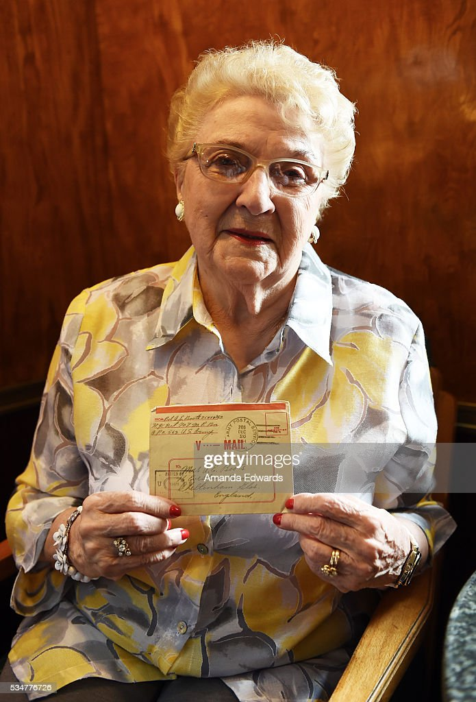 World War II 'War Bride' June Boots Allen holds a V-Mail letter from her first husband while attending the 80th anniversary celebration of the Queen Mary's maiden voyage at The Queen Mary on May 27, 2016 in Long Beach, California. Boots Allen, now 88, departed Southampton, England aboard the Queen Mary on February 3, 1946 for her new life in the United States after marrying a G.I. soldier.