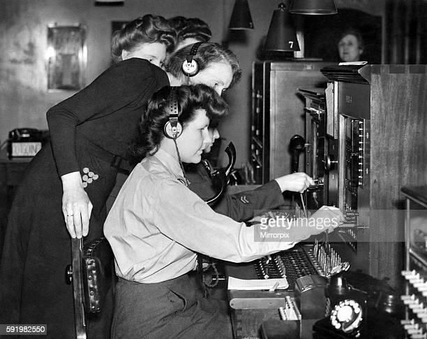World war II Women Hello girls training school WAAF girls receiving instruction on the switch boards May 1944 P010255
