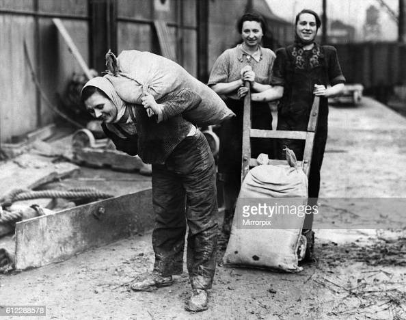 Women Dockers at a Northern Port Mrs Hunter mother of four children whose husband is in the forces photographed at work on the docks November 1941...