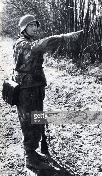 World War II1943 1944 German soldier in camouflage uniform during an action against the italian partisans in the North of Italy