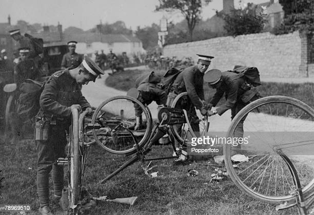 circa 1915 Deanshanger Northamptonshire England Men of the Kent Cyclists Corps repairing punctures on their bikes