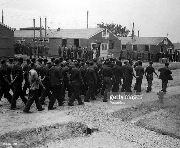 World War Two A group of German prisoners of war line up outside the mess hall as meal time nears at POW camp in Kentucky USA