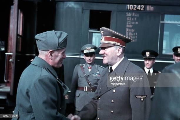 German Nazi leader Adolf Hitler shakes hands as he meets Italian leader Benito Mussolini