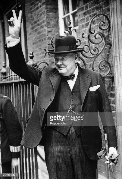 World War Two London England British Prime Minister Winston Churchill gives the famous vsign for victory on the steps of Number 10 Downing Street