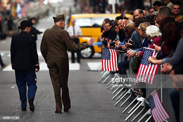 World War Two veteran Gene Cannava walks in the annual Veteran's Day Parade along Fifth Avenue on November 11 2014 in New York City Often called the...