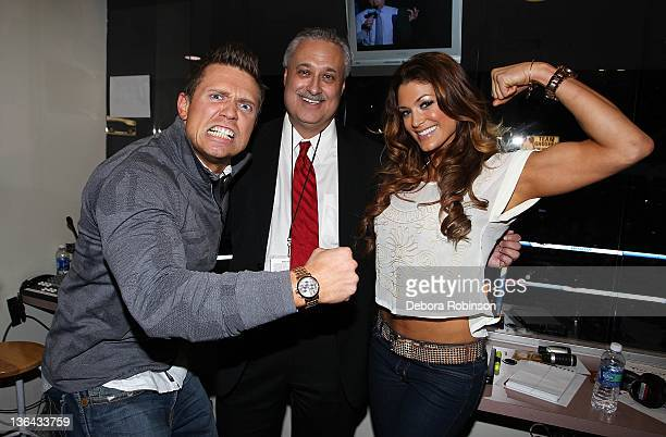 World Wresting Entertainment's Mike 'The Miz' Mizanin and 'Diva' Eve Torres pose for a photo with Anaheim Ducks announcer Steve Carroll during the...