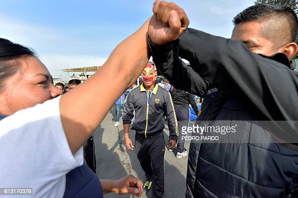 World wrestling champion Red Dragon Jr gives instructions while training local police in Iztapalapa neigbourhood in Mexico City to help them subdue...