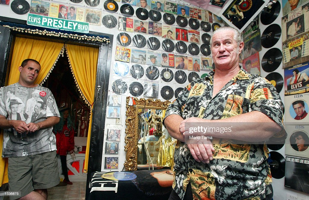 'World's Biggest Elvis Fan' Paul McLeod (R) gives a tour of his 'Graceland Too' house during Elvis Week August 14, 2002 in Holly Springs, Mississippi. The house is filled with Elvis collectibles and is run by McLeod and his son Elvis Presley McLeod (L). The house is open 24 hours a day, 365 days a year. Up to 75,000 fans are expected to attend the celebration of all things Elvis in Memphis which this year marks the 25th anniversary of the singer's death.