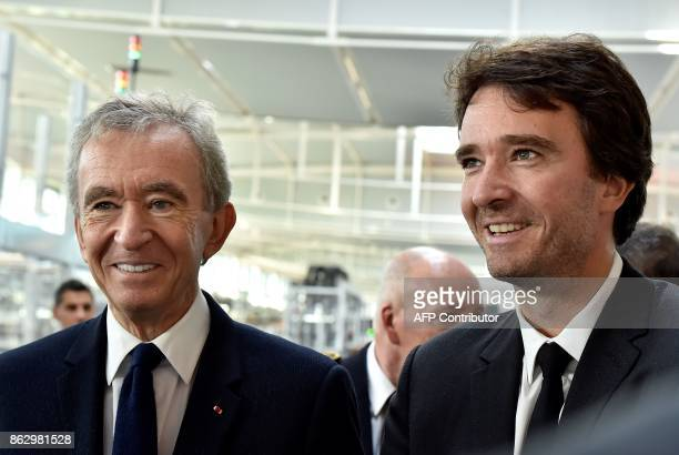 World's biggest luxury goods company LVMH's CEO Bernard Arnault and his son Antoine visit the world leader for the production of Cognac Hennessy's...