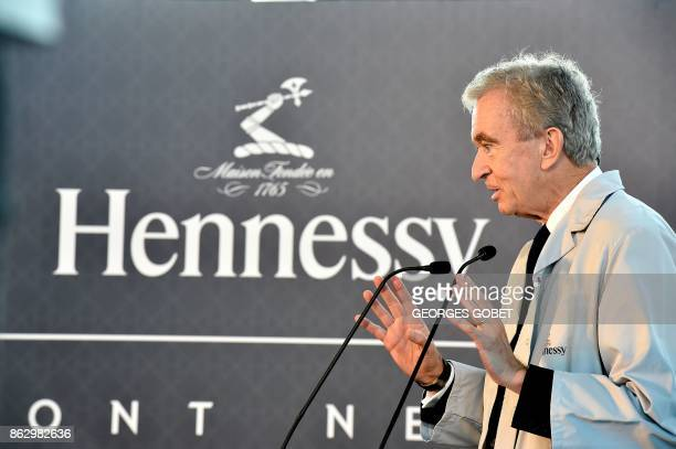 World's biggest luxury goods company LVMH's CEO Bernard Arnault addresses employees as he visits the world leader for the production of Cognac...