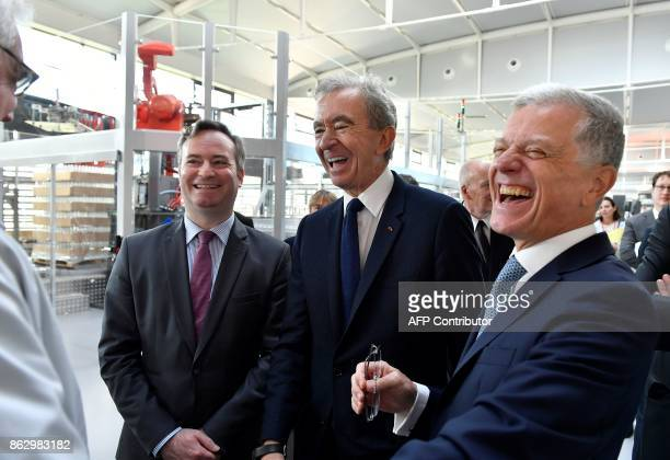 World's biggest luxury goods company LVMH's CEO Bernard Arnault French Junior Minister for Foreign Affairs JeanBaptiste Lemoyne and 'maison Hennessy'...