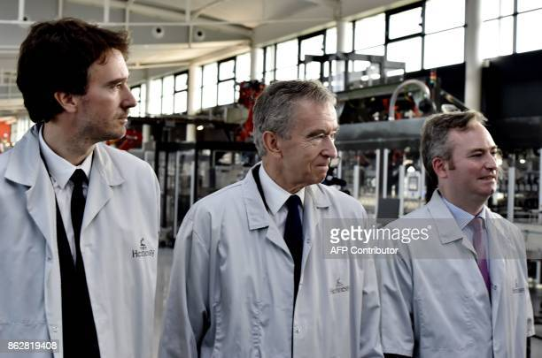 World's biggest luxury goods company LVMH's CEO Bernard Arnault his son Antoine and French Junior Minister for Foreign Affairs JeanBaptiste Lemoyne...