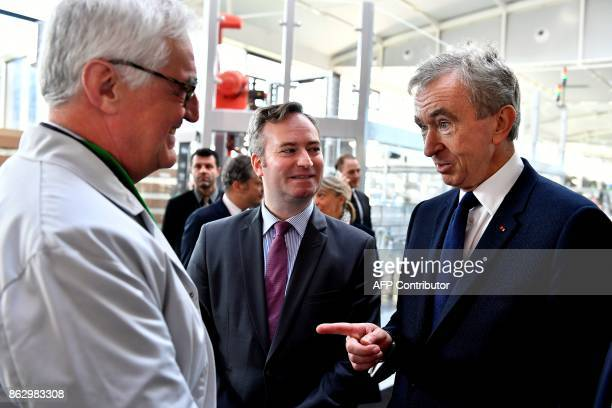 World's biggest luxury goods company LVMH's CEO Bernard Arnault talks to a technician as French Junior Minister for Foreign Affairs JeanBaptiste...