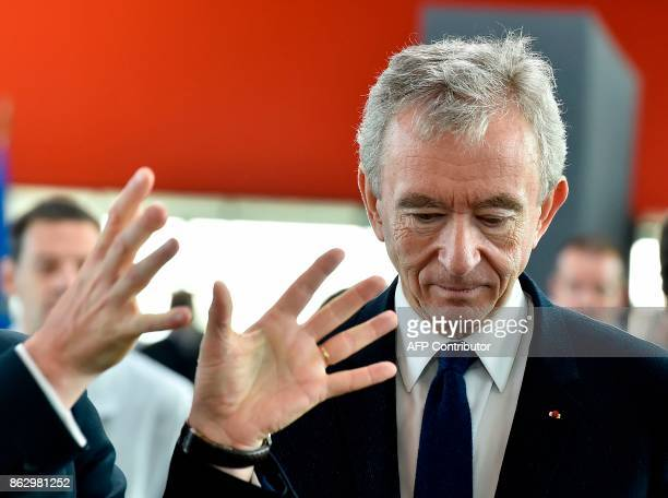 World's biggest luxury goods company LVMH's CEO Bernard Arnault visits the world leader for the production of Cognac Hennessy's new bottling plant on...