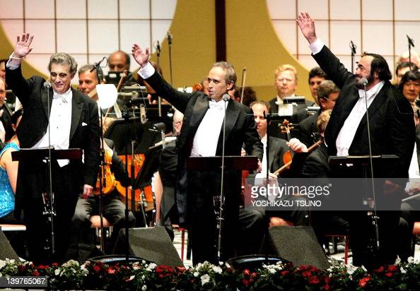 World's famous three tenors Placido Domingo Jose Carreras and Luciano Pavarotti waves to crowded audience after the performance of encores of the...