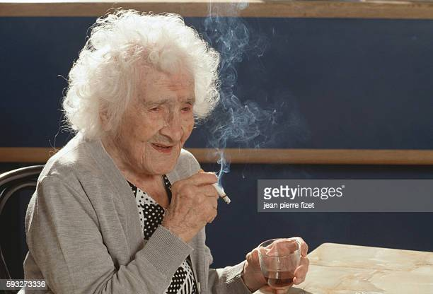 World's oldest person Jeanne Calment enjoys her daily cigarette and glass of red wine on the occasion of her 117th birthday
