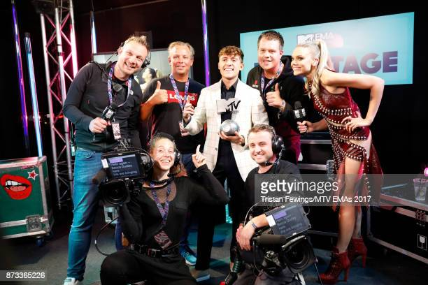 Worldwide Act award winner Lil' Kleine poses with staff backstage during the MTV EMAs 2017 held at The SSE Arena Wembley on November 12 2017 in...