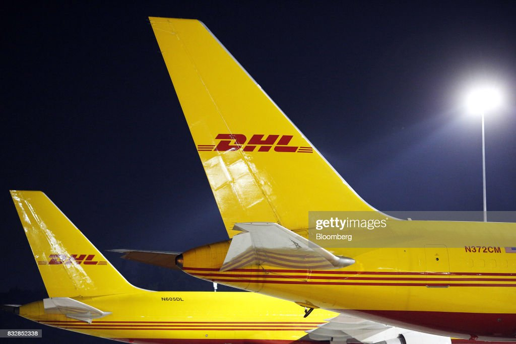 DHL Worldwide Express cargo jets sit parked on the tarmac at the company's hub of Cincinnati/Northern Kentucky International Airport in Hebron, Kentucky, U.S., on Wednesday, Aug. 16, 2017. The Deutsche Post AG, parent company to Worldwide Express, second-quarter operating profit jumped 12 percent as the German mail operator handled more express deliveries and won more business at its logistics unit. Photographer: Luke Sharrett/Bloomberg via Getty Images