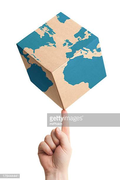 Worldwide parcel delivery cardboard box and world map