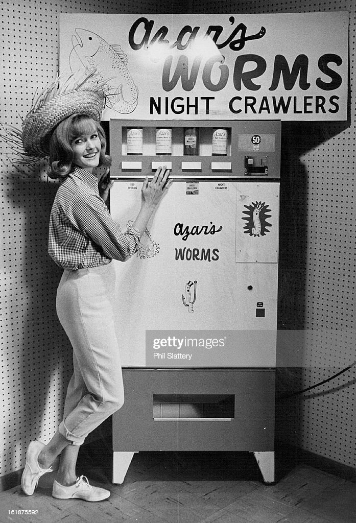 MAY 3 1965, JUN 4 1965, JUN 6 1965; Worms, Anyone ?; The first 20 temperature-controlled vending machines for worms are now in locations in Denver, Walden and Granby, and within 30 days more than 140 of the machines will be spotted throughout Colorado, Zachary W. Azar, head of Azar's Canned Worms, 2046 Araphahoe St., said. The machines, believed to be the first in the nation for worms, provide the fisherman with choice of red worms, garden worms or night crawlers. Chees' Mallows first bait is also available. Azar, former president of Azar's Auto Supply, 801 Broadway, says the first installations have proved highly successful. Marcia Higgins, dressed for an outing, approves of the quick, clean way to get worms.;