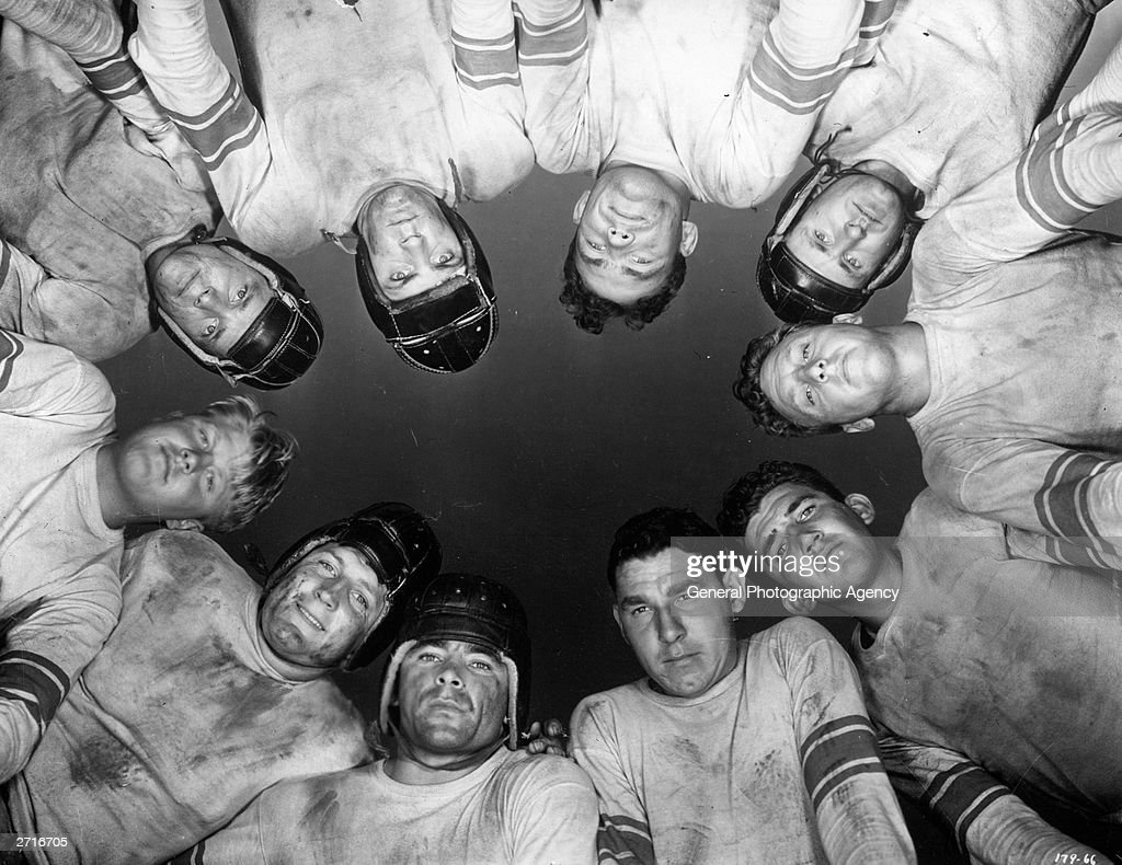 Worm's eye view of a group of American football players.