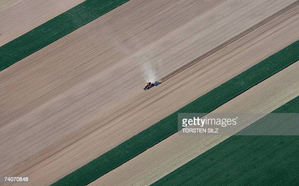 An aerial view taken 02 May 2007 shows a tractor plowing a field near Worms western Germany AFP PHOTO DDP/TORSTEN SILZ GERMANY OUT