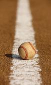 Worn Baseball on the Infield Chalk Line