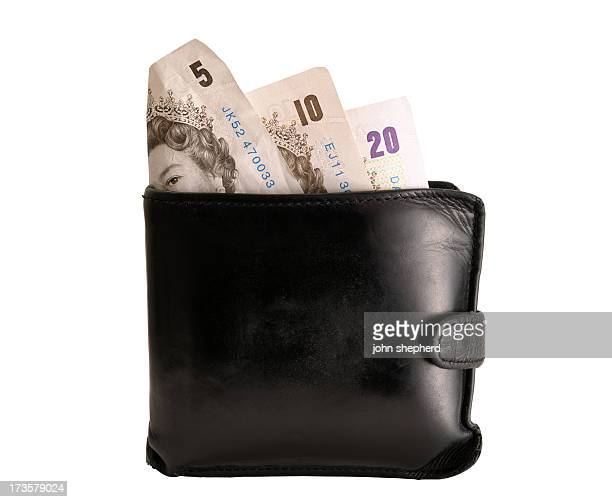 worn wallet with pound notes exposed