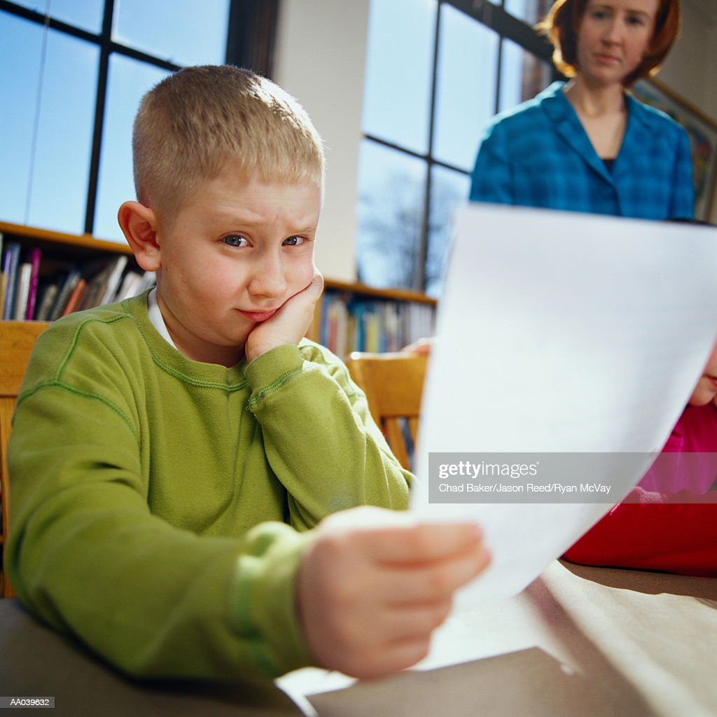 Worried Boy Studies School Work : Stock Photo