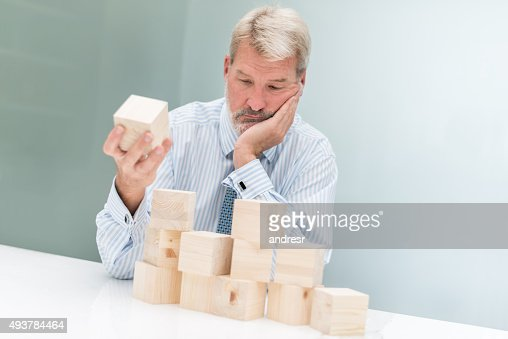 worried business man building a project stock photo