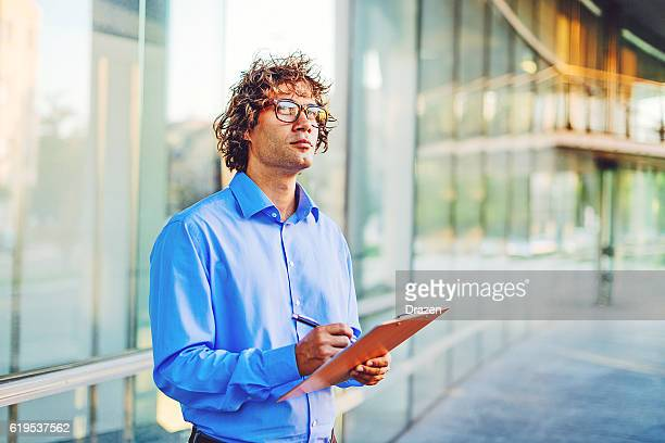 Worried businessman decides to sign contract or not