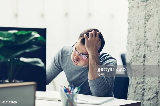 Worried businessman in office.