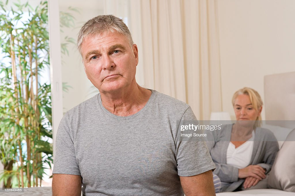 Worried couple in bedroom : Stock Photo