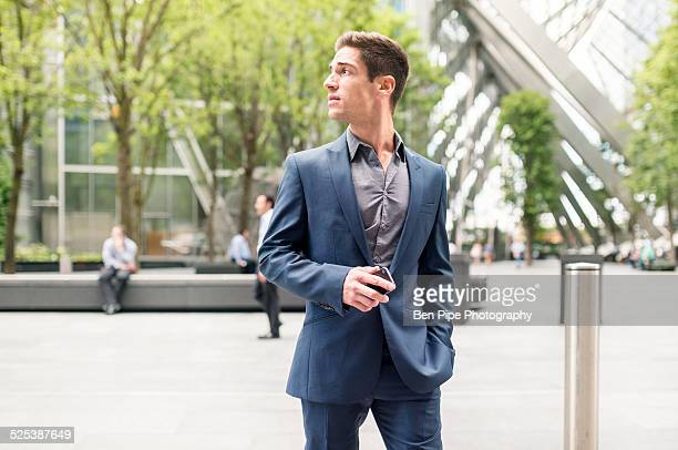 Worried looking young businessman at Broadgate Tower, London, UK