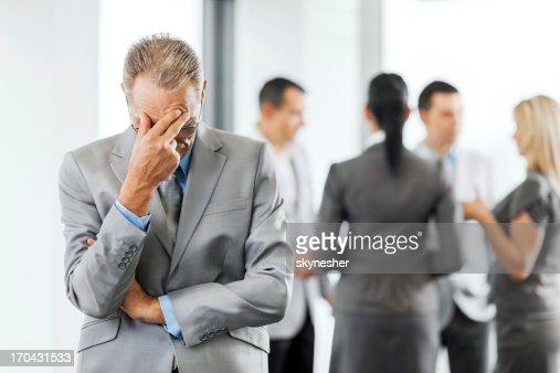 Worried mature businessman