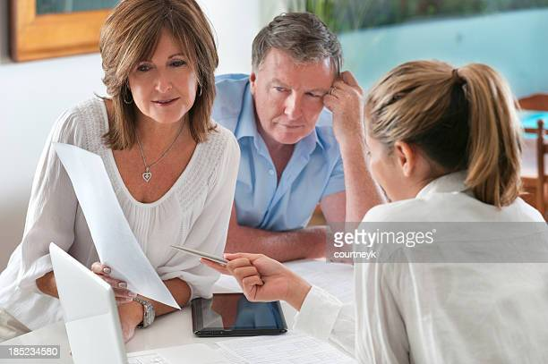 Worried mature Couple in Meeting With Advisor