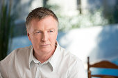Worried mature man looking away from camera